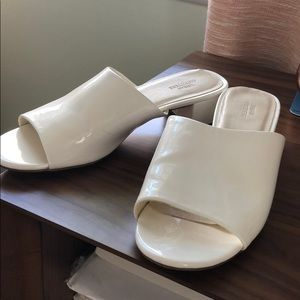 white patent heeled mule sandals